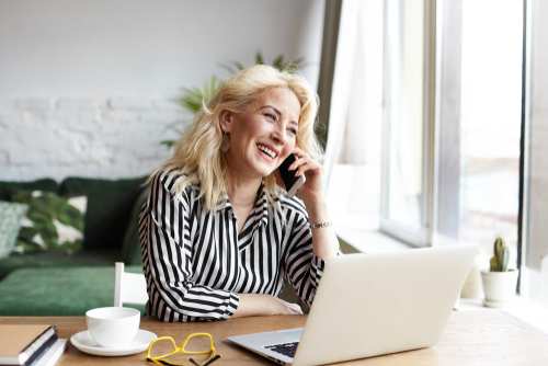 middle-age-woman-phone-laptop